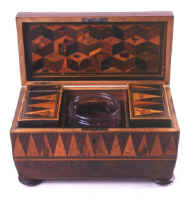 Tunbridge ware tea chest with parquetry in various woods, the interior canisters continuing the pattern of the sides, circa 1825. eg01.jpg (56925 bytes)
