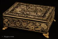 JB706: Penwork decorated  box made in gessoed beech and standing on embossed gilded brass feet. This particular box is very reminiscent of Anglo Indian work, both in the contrast of black on white which resembles ivory incised decoration. The patterns of plants and flowers are executed in the manner of fabric and embroidery design, which was fashionable in penwork of the period. However the top design goes further than most such work, in that the peacock is central to an asymmetrical tree of life motif which is characteristic of 18th century Indian inlaid work. Exceptionally well designed and executed.  Circa 1790.