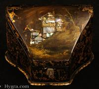 Papier mâché stationery box of interesting form, which takes advantage of the special qualities of the material. It is inlaid in mother of pearl and painted with  houses seemingly built on the side of a mountain. The color and a bare tree suggest winter. The shape of the box is complementary to the design, in that it curves upwards in line with the pictured landscape. A sensitive and clever combination of form and decoration combining the two with artistic integrity. The compartmentalized interior is lined with the original 19th Century paper.