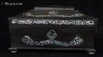 Shaped coromandel ebony box with mother of pearl inlay depicting stylized flora,