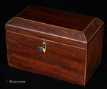 735TC: Two compartment tea caddy with saw-cut mahogany cross banded with boxwood. Inside the two compartments have supplementary lids of solid mahogany with turned handles.  The Caddy retains some of its original lead foil on the inside. Circa 1800.