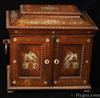 691SBCAB: An impeccably made,  high quality, William IV, fully fitted, figured rosewood,  table cabinet of architectural form, profusely  inlaid with mother of pearl depicting stylized flowers on the top,  and on the doors depiction of perched birds of prey.    The top compartment, which is all original with canary yellow silk is fitted for sewing;  it  retains its period mother of pearl topped spools and tools.