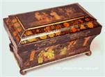 TC 107:  A polychromed tea chest with scenes of oriental life. The pictures are skillfully painted in the manner of the Company school of painting. The original varnish survives, albeit understandably cloudy. Exceptional. Circa:  1815-20.