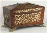 TC133: A Rosewood three compartment  brass Inlaid Tea Chest with gadrooned framings having twin lift-out  wooden canisters flanking a cut crystal bowl standing on embossed gilded brass feet and with drop handles, Circa 1825.