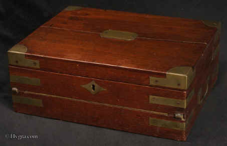 WB458: A mahogany brass bound box which is an example of  a combined dressing case and writing desk. The lift out dressing tray is fitted for holding a man's grooming accessories. This is a very unusual arrangement.  Circa 1800. Enlarge Picture