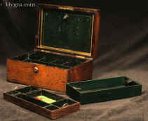"A very finely figured rosewood box with  brass inlay by D Edwards, with working Bramah lock. The inside is compartmentalized and lined in silk and leather. The box has two  lift out trays with velvet and leather linings. There are two additional little leather covered drawers at the bottom of the box. The wonderful green silk is original. There is a silk and leather document wallet with  a blotting pad.  The box has a patented by Edwards hinge which is reminiscent of a hinge for snuff boxes invented by James Sandy.   the lift out  blotting pad is embossed with gold lettering ""D. EDWARDS - MANUFACTURER TO HER MAJESTY - 21 KING STREET - BLOOMSBURY - LONDON"""