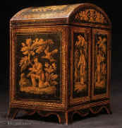 Penwork table cabinet  with curved Regency shape. The penwork depicts exquisite chinoiserie  scenes of figures in the fantastical gardens of Cathay.  The compartmentalized interior was fitted for jewelry in the 19th Century.  The hinged doors open to  four drawers with turned bone handles. The upper part was originally fitted for sewing. The divisions retain their original pink lining paper. The domed top and  flared skirted base are unusual. Enlarge Picture