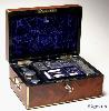 JB316: Brass edged flame mahogany fully fitted dressing box with inset brass handles and Bramah lock opening to a leather covered lift out tray with cut glass bottles with hallmarked silver tops (1827-9) a document wallet in the lid. Circa 1830.