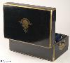 JB420: Brass bound French ebonized box by L. Aucoc aine, Paris with inlaid armorial Achievement for Bingham/ Pemburton/ Chaldicott. The box has a working Bramah lock, opening to a leather and silk covered compartmentalized interior. There are compartments and small containers which fit snugly into their allotted spaces. There is also a 'secret' sprung drawer. Everything is covered in original leather and silk. The hinge is heavy allowing for the weight of the box. It also has the self supporting structure which helps the heavy lid stay open.  Circa 1860.