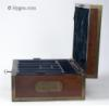 JB444: Impressive brass edged box in mahogany circa 1820.  This is a box of larger than usual proportions. The quality of both the materials and the workmanship is outstanding. The lines of the top change as the interesting figure, the result of cutting the wood at an angle, catches different light values with the slightest move. The interior tray is original and covered in the original leather. Removable velvet covers have been made so as to protect the leather and make the box more useable. The  Bramah lock has a working key. The gauge of the brass is thick and compliments the heaviness of the wood. The flat-folding handles further accent the mahogany. The hinge is of an interesting construction designed to support the heavy structure of the box. The fold down 'envelope' cover is covered in the original tussled velvet and retains the early 19th century marbled paper.