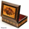 JB178:  A rosewood veneered Tunbridge ware box by T Barton, the slightly domed top inlayed with a display of roses depicted in micro mosaic,  framed by bandings of contrasting light and dark wood and particularly well matched geometric micro mosaic; there is a further banding of Berlin wool work Design encircling the box. The inside is lined with its original red paper. Circa 1850.