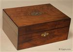 Ref: 636SB: Antique mid Victorian  sewing box veneered with figured walnut accented with brass white metal and mother of pearl and opening to a lift -out tray retaining its original  silver paper covering and supplementary silk covered lids Circa 1860. Enlarge Picture