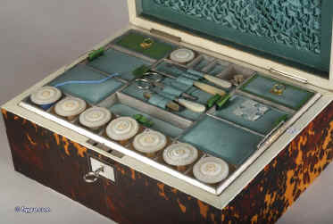SB121: A rare fully fitted tortoiseshell sewing box of rectangular form and shaped top by Thomas Lund of Cornhill, having ivory facings, silvered hinges and lock, mother of pearl escutcheon and name plate engraved