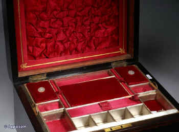 SB124: Victorian figured coromandel sewing box  with mother of pearl cartouche and escutcheon, the inside with fitted liftout tray  with silk covered supplementary lids, Circa 1860.   Enlarge Picture