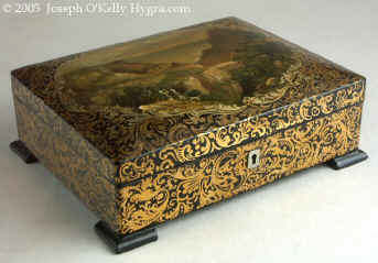 SB101: An artist painted Papier mâchè sewing box having its original fully fitted tray with  Dieppe  turned and carved  spools and sewing tools. Circa 1820.