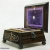 Victorian fully fitted coromandel sewing box of architectural shape inlaid with mother of pearl abalone and metal, with turned handles and feet.  circa 1845 Enlarge Picture