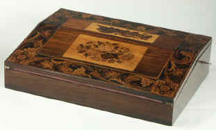 A Tunbridge ware writing slope veneered with rosewood and decorated with micro mosaic depicting floral subjects. Circa 1850