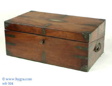 """An Early 19th C solid Mahogany writing box with elaborate and unusual secret compartments screw-down mechanism and historical asociations.  The top has a brass plate inscribed """"Colonel L'Estrange K.C.M"""" The L'Estranges are an old established Anglo-Irish family. They first came to Ireland with Earl Strongbow in A.D. 1149 and married the daughter of the last king of Ireland Rory O'Connor."""