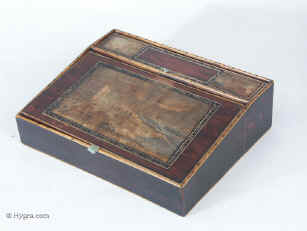 A Rare faux rosewood writing slope with scenes depicting the Brighton storms. The hand coloured engraving on the top of the box is by J Bruce a local publisher.   Circa 1830
