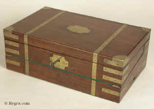 A Georgian Mahogany Triple Opening brass bound Writing Box circa 1815 with original inkwells and secret drawers. The box is in the military style and has countersunk carrying handles made of brass as well as brass corners and straps.
