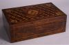 An extremely rare writing box, made as a special commission, featuring Masonic symbols on a parquetry background. Circa 1840