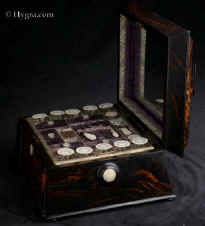 SB492: An impressive sewing box veneered in saw cut highly figured coromandel, fitted with mother of pearl sewing tools. Enlarge Picture