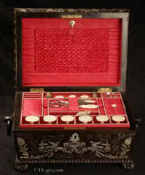 SB488: A sewing box of impressive form, decoration and workmanship, the interior lined with red silk and fully fitted with mother of pearl sewing tools, Circa 1825. Enlarge Picture