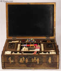 SB498: An early 19th Century  fully fitted Chinese export lacquer combined sewing and writing box of rectangular form opening to a fully fitted sewing tray with turned and carved ivory tools and having a drawer fitted for writing. Circa 1800  Enlarge Picture